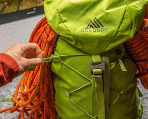 Bungee ice axe and crampon holder